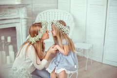 A happy mother and her daughter are going to kiss Stock Photography