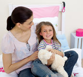 Happy mother and her daughter having fun Stock Image