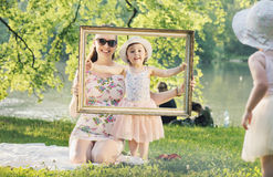 Happy mother and her daughter having fun in a park Royalty Free Stock Photo
