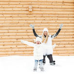 Happy mother with her daughter jumping outdoors Stock Photography