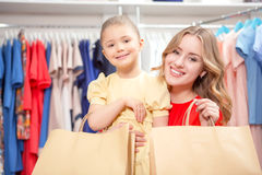 Happy mother with her daughter and lots of new Stock Image