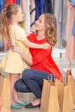 Happy mother with her daughter and lots of new Royalty Free Stock Photography