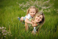 Happy mother and her daughter outdoors Royalty Free Stock Photos