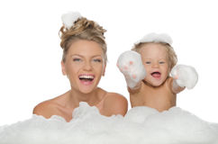 Happy mother with her daughter and soap foam Stock Photo