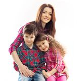Happy mother with her daughter and son. Portrait of children with her mother. Isolated white background. Spring, March 8, International Womens, Mothers day Stock Photography