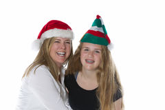 Happy mother and her daughter wearing Holiday hats Stock Images