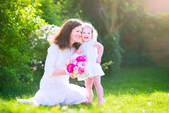 Happy mother and her funny daughter in garden Royalty Free Stock Images