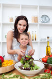 Happy mother and her girl preparing a salad Royalty Free Stock Photo