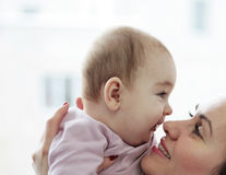 Happy mother with her happy baby Stock Photography
