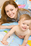Happy mother with her little boy Stock Photos