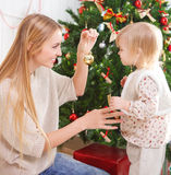 Happy mother with her little daughter. Christmas Royalty Free Stock Photos