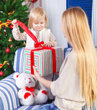 Happy mother with her little daughter. Christmas Stock Images