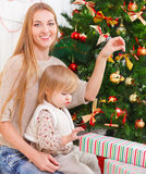 Happy mother with her little daughter. Christmas Royalty Free Stock Image