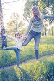 Happy mother and her little daughter having fun Stock Photo