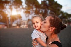 Happy mother and her little daughter outdoor stock photo
