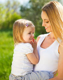 Happy mother and her little daughter in the spring Stock Photography