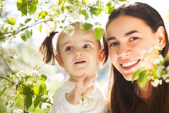 Happy mother and her little daughter in the spring Royalty Free Stock Photo