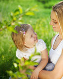 Happy mother and her little daughter in the spring Royalty Free Stock Photos