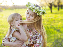 Happy mother and her little daughter in the spring day Stock Photo