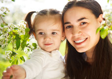 Happy mother and her little daughter in the spring day Royalty Free Stock Photo