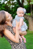 Happy mother and her little daughter in the summer field Stock Photography
