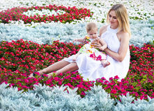 Happy mother and her little daughter in the summer Stock Photos