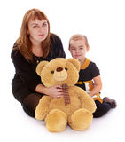 Happy mother with her little daughter and teddy Stock Photos