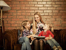 Happy mother and her little daughters indoors Royalty Free Stock Photo