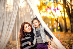 Happy mother and her little son playing in the park Stock Images