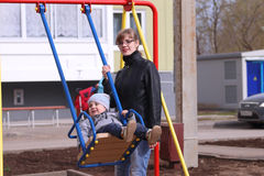 Happy mother and her little son swings Stock Photography