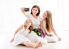 Happy mother with her pretty little girls making selfie Royalty Free Stock Images