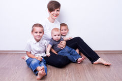 Happy mother and her smiling children Stock Photos