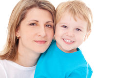 Happy mother and her son. Happy pretty mother embracing her adorable smiling son Royalty Free Stock Images