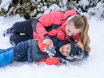 Happy mother with her son in an arms embrace on the snow. Happy mother with her son embracing outdoors on the snow Royalty Free Stock Photography