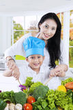 Happy mother and her son cooking together Stock Photography