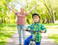 Happy mother with her son having fun, riding a bicycle Royalty Free Stock Photo