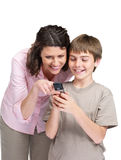 Happy mother and her son using a mobile phone Royalty Free Stock Photo