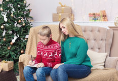 Happy mother and her son writing letter to Santa Royalty Free Stock Photo