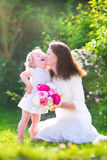 Happy mother and her sweet daughter in the garden Royalty Free Stock Photos