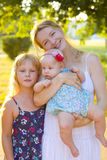 Happy mother with her two daughters. Portrait of a beautiful young women with her two daughters Stock Image