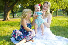 Happy mother with her two daughters. Portrait of a beautiful young women with her two daughters Stock Photos