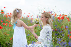 A happy mother and her young daughter are having fun. Girl is h Royalty Free Stock Photography