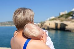 Happy mother and his little daughter at beach Stock Photography