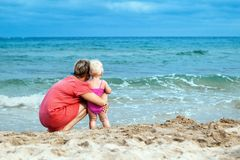 Happy mother and his little daughter at beach Royalty Free Stock Images