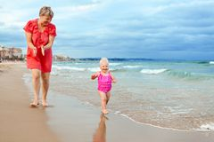 Happy mother and his little daughter at beach Stock Photo