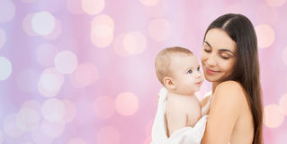 Happy mother holding adorable baby Royalty Free Stock Images