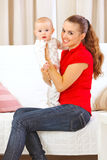 Happy mother holding adorable baby in hands Royalty Free Stock Photos