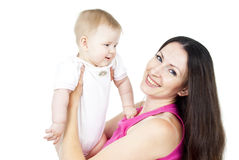 Happy mother holding a baby Royalty Free Stock Photography