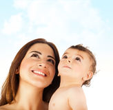 Happy mother holding baby boy Stock Image