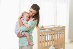 Happy mother holding baby boy Stock Images
